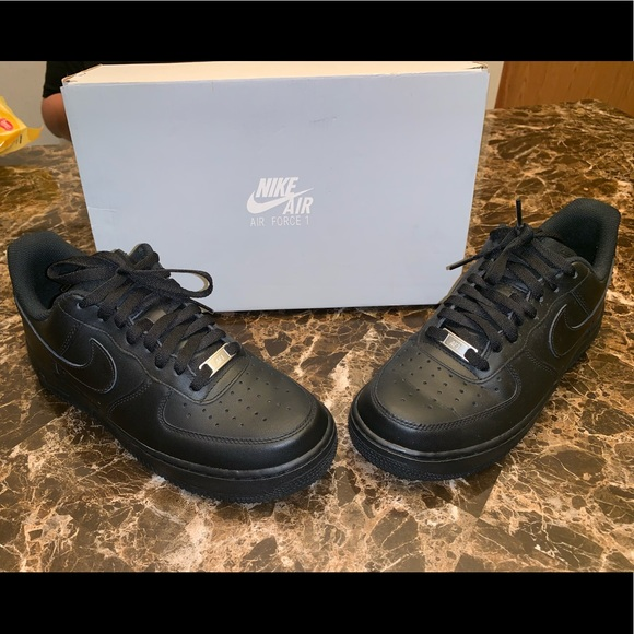 All black Nike Air Force Ones, men size 8